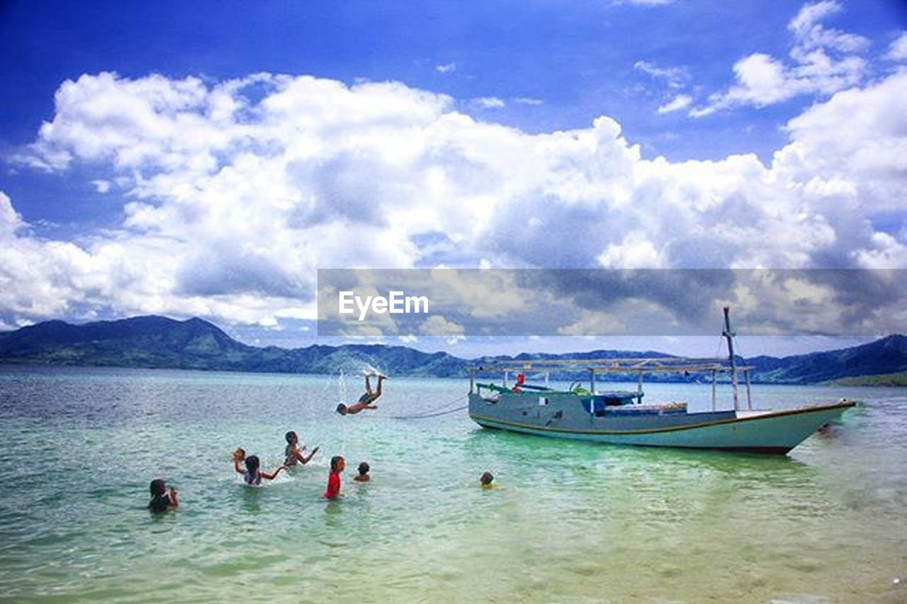cloud - sky, sea, beach, water, sky, vacations, mountain, nautical vessel, day, adult, travel destinations, men, outdoors, people, scenics, beauty in nature, nature, swimming, women, adults only