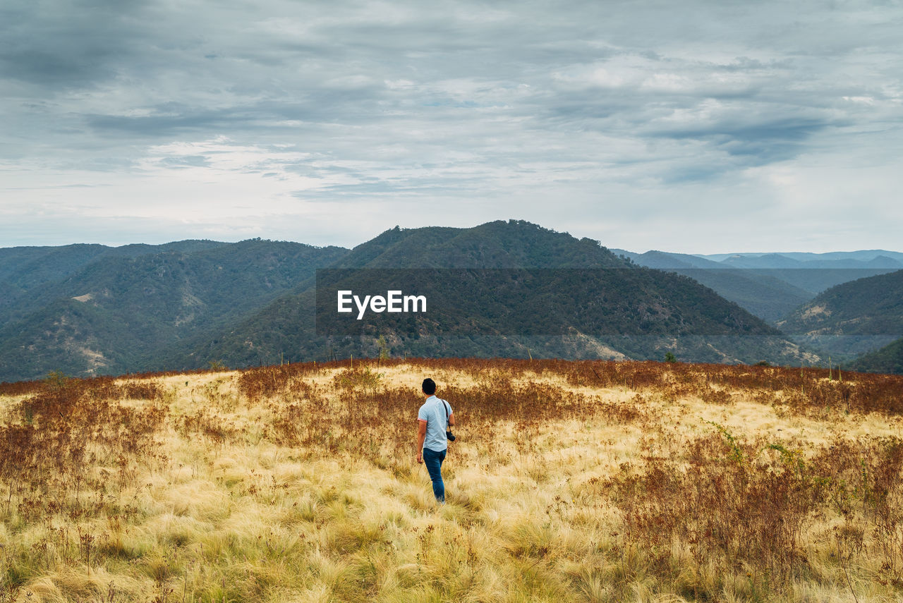 Man walking on countryside landscape
