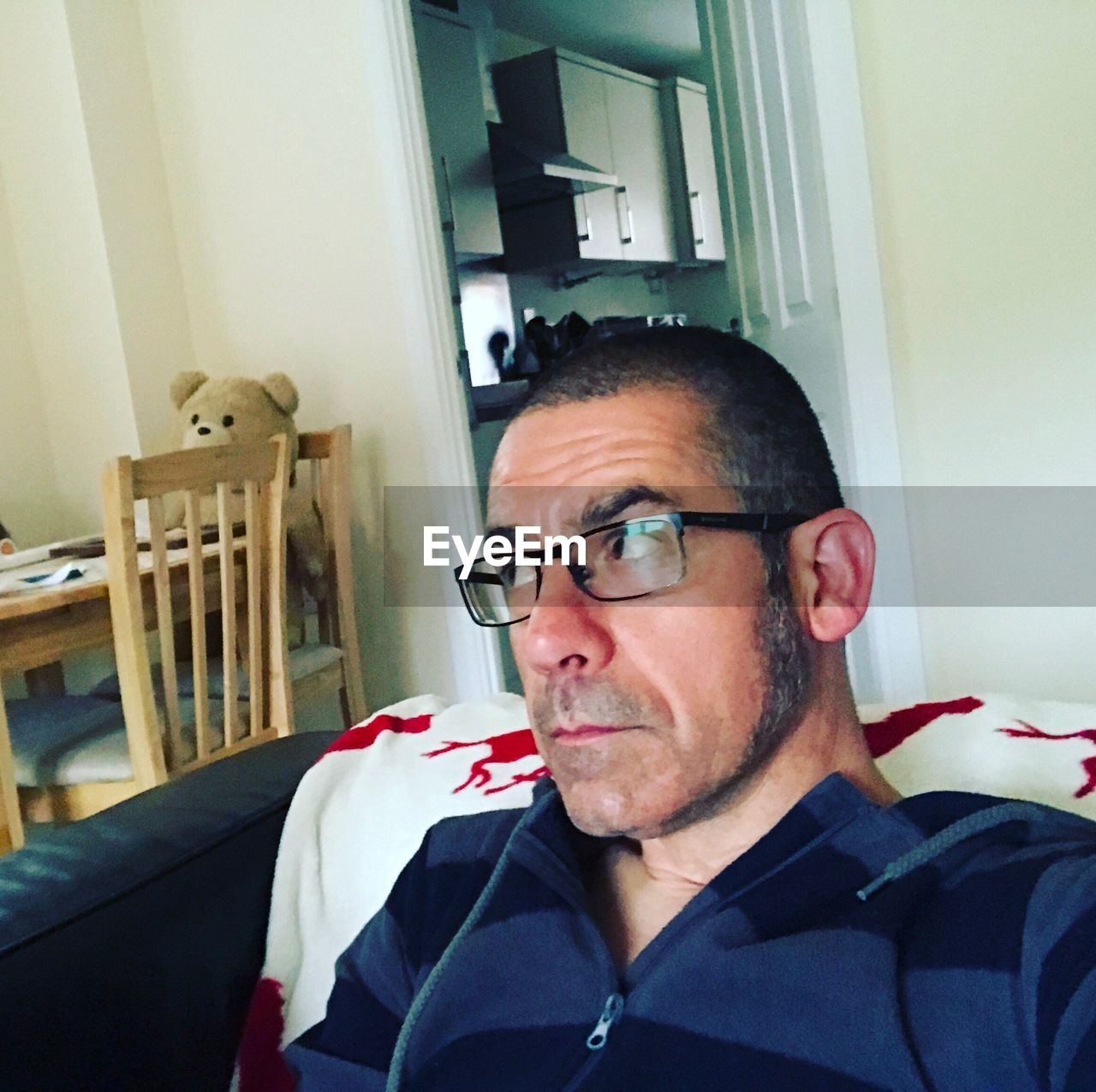one person, real people, eyeglasses, indoors, lifestyles, mature men, home interior, leisure activity, glasses, mature adult, front view, close-up, headshot, day, young adult