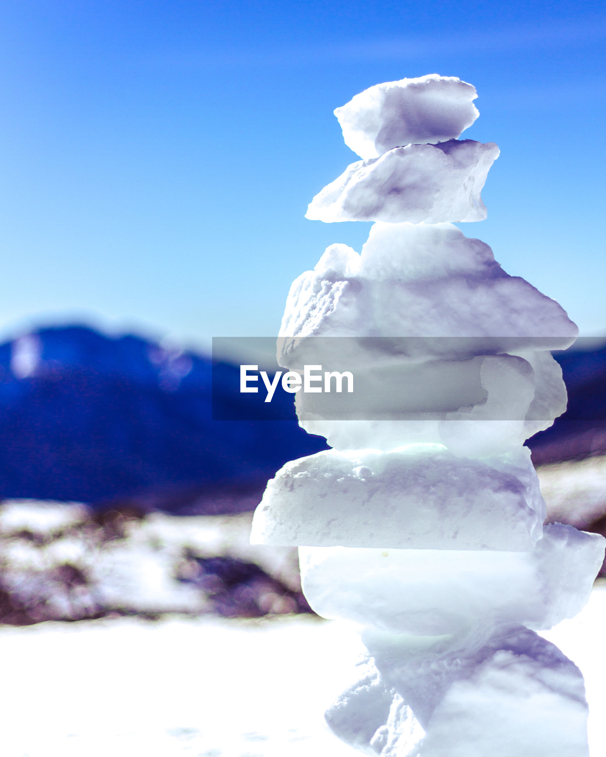 CLOSE-UP OF SNOW COVERED STACK