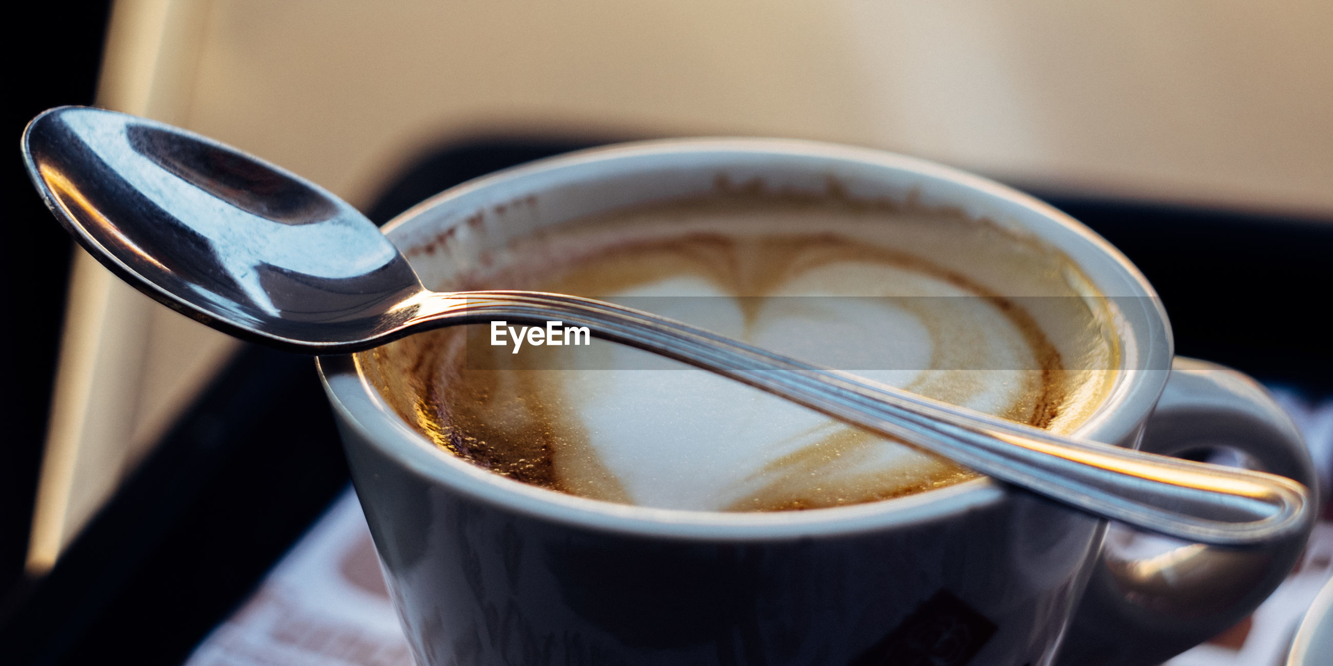 Close-up of coffee and spoon on table