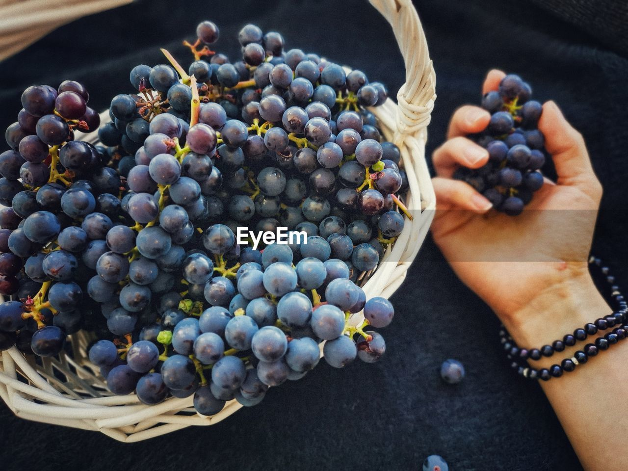 High angle view of grapes in basket