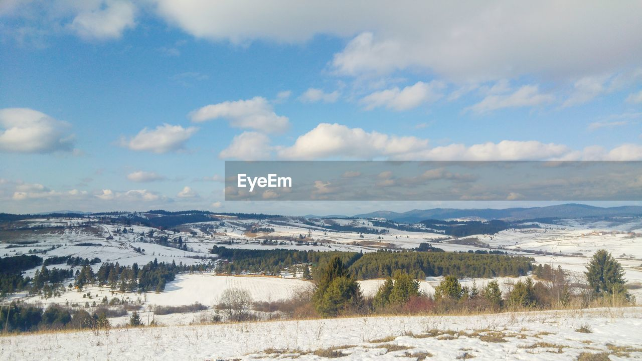 Snowcapped plateau and scattered clouds