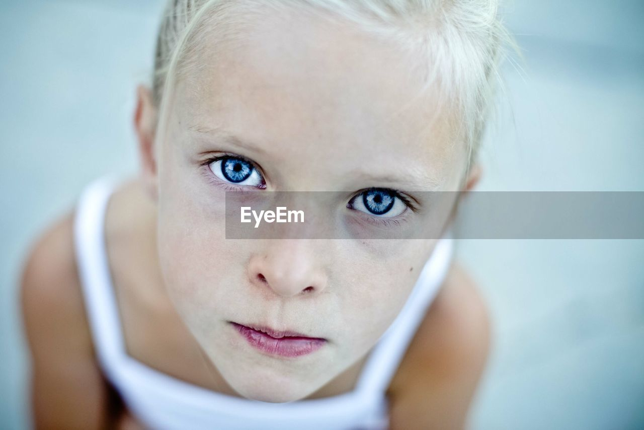 Close-up Portrait Of A Cute Girl With Blue Eyes