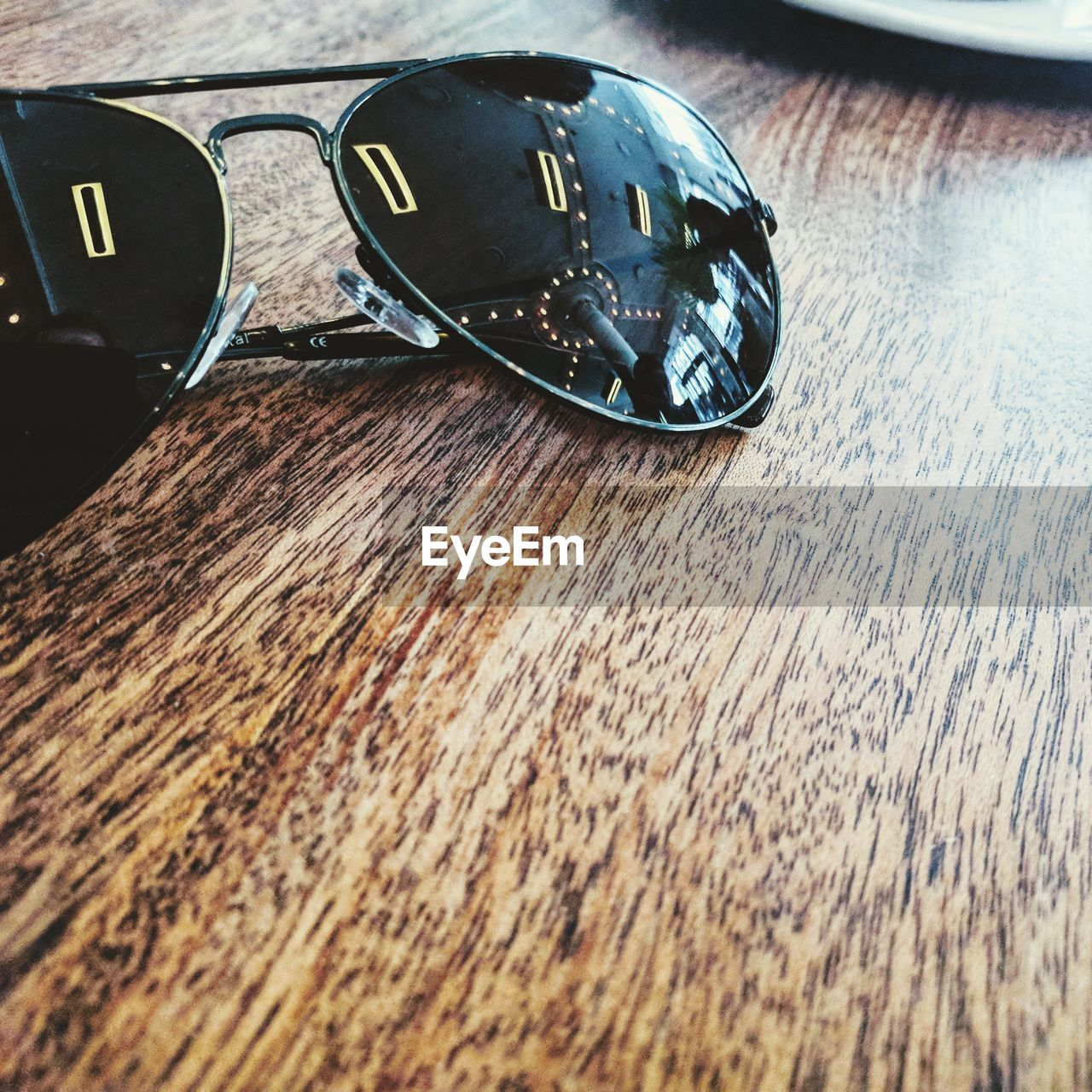 wood - material, table, close-up, still life, indoors, no people, glasses, personal accessory, fashion, high angle view, metal, sunglasses, selective focus, day, reflection, security, protection, safety, wood, single object, silver colored