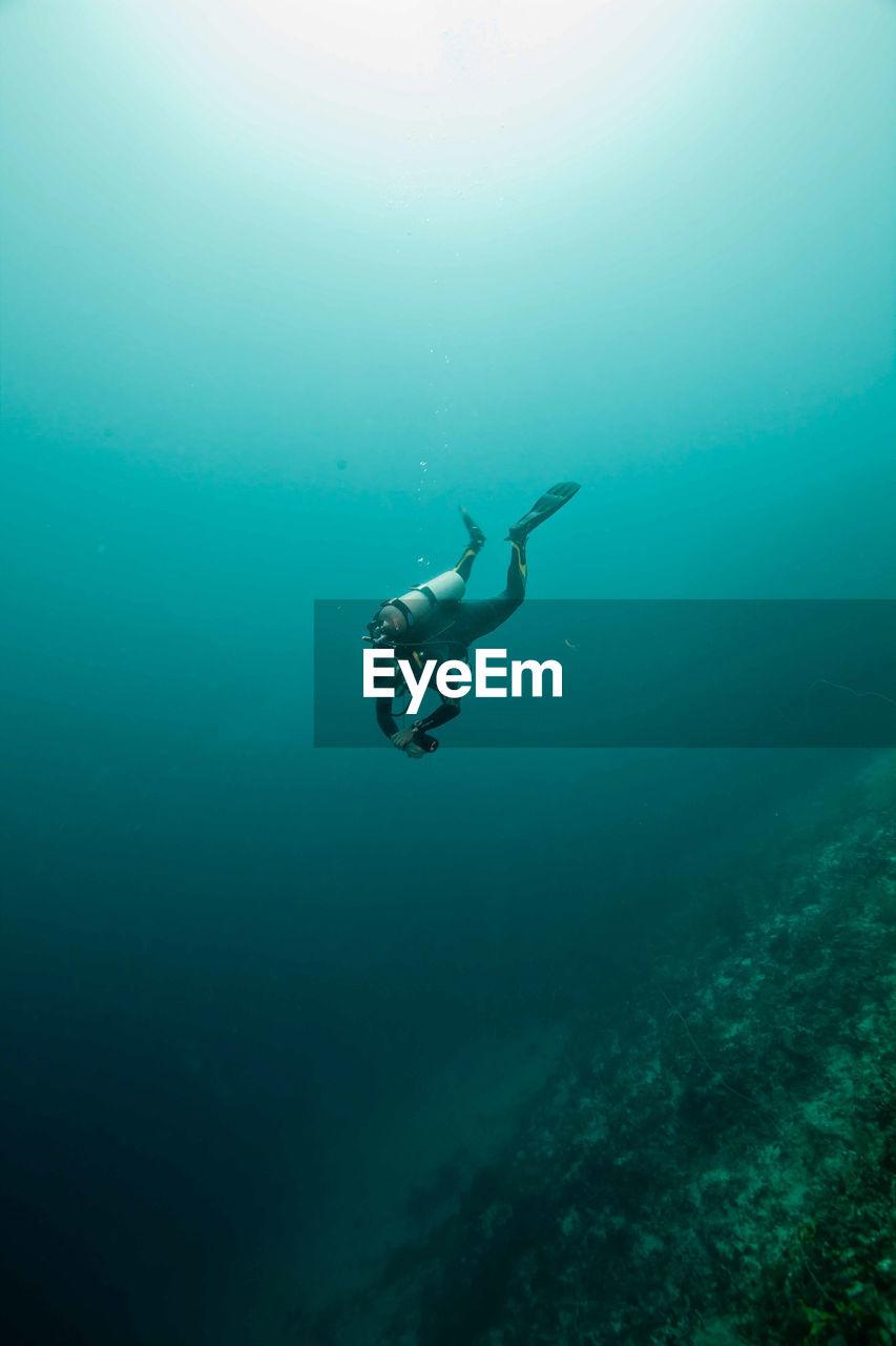 Scuba Diver Swimming Underwater