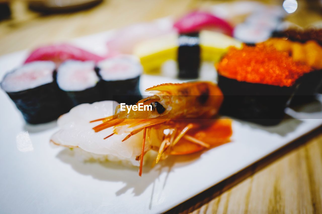 close-up, indoors, animal, seafood, food, no people, orange color, plate, fish, food and drink, focus on foreground, selective focus, table, ready-to-eat, animal themes, vertebrate, serving size, crustacean, freshness, still life, japanese food