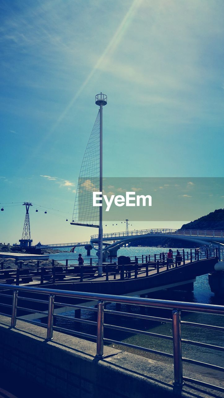 sky, architecture, built structure, water, cloud - sky, nature, transportation, building exterior, city, river, nautical vessel, connection, outdoors, bridge, mode of transportation, railing, day, tall - high, travel, bridge - man made structure, no people, sailboat, bay