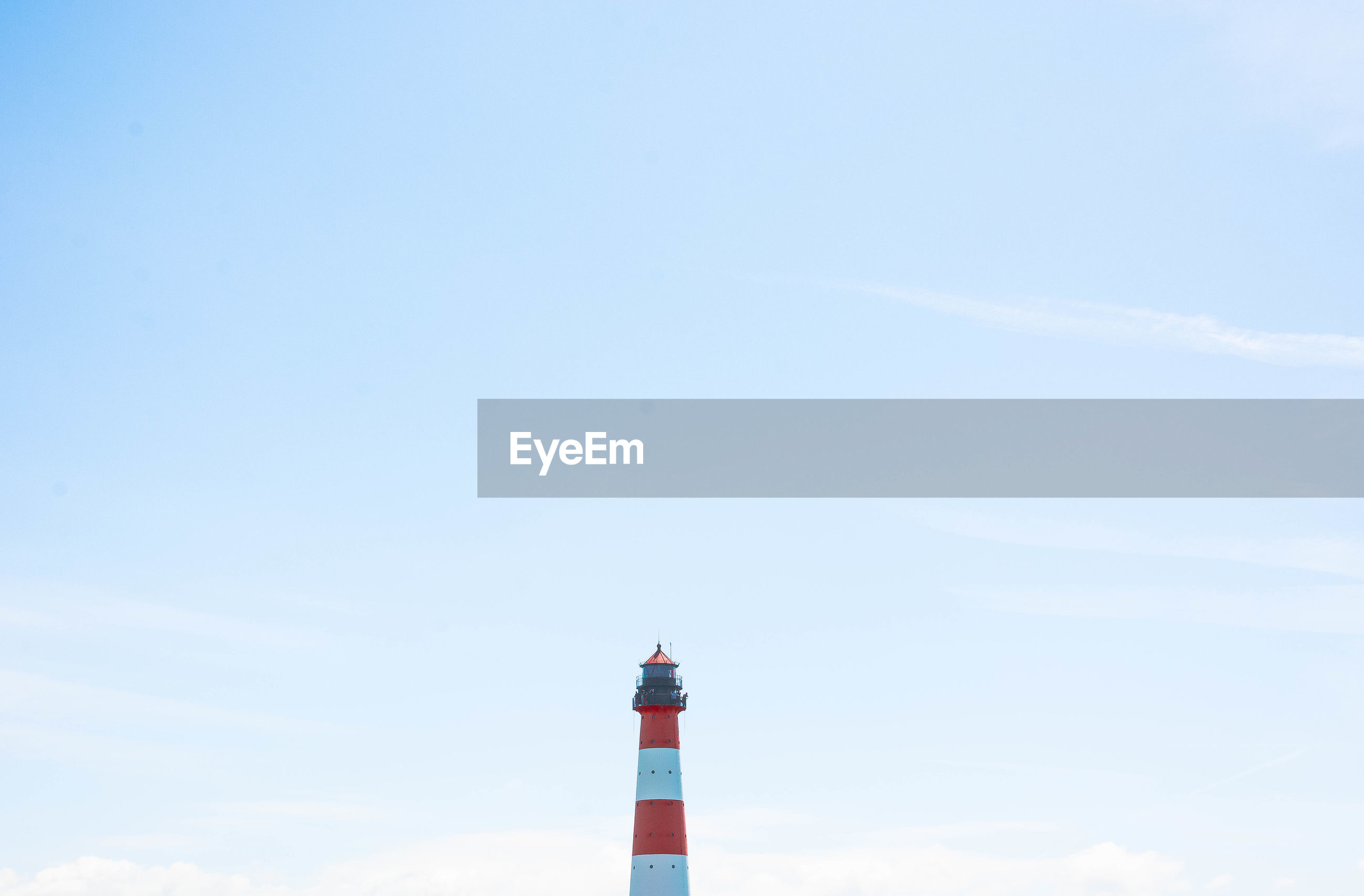Mid distance view of lighthouse against sky