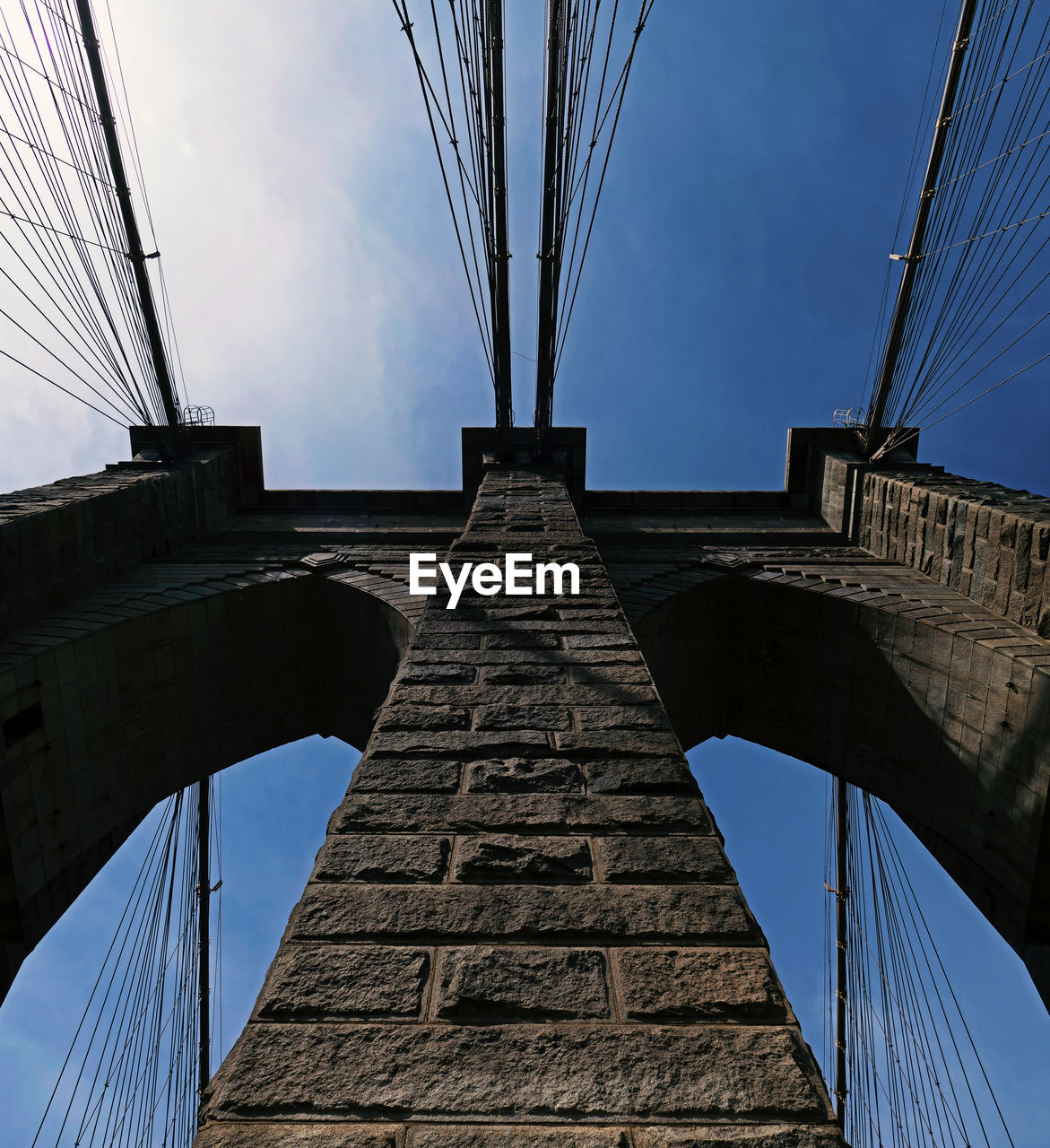architecture, built structure, sky, connection, low angle view, bridge, bridge - man made structure, engineering, nature, transportation, tourism, travel destinations, travel, day, tall - high, outdoors, cloud - sky, tower, metal, directly below