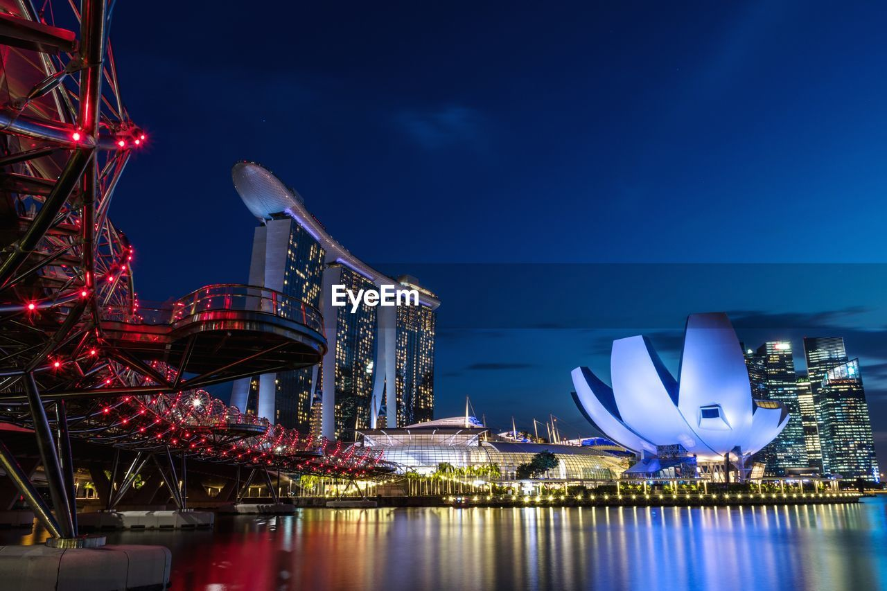 illuminated, night, architecture, built structure, building exterior, sky, water, reflection, city, travel destinations, nature, no people, amusement park, tourism, arts culture and entertainment, river, amusement park ride, ferris wheel, outdoors, office building exterior, luxury, skyscraper, bay