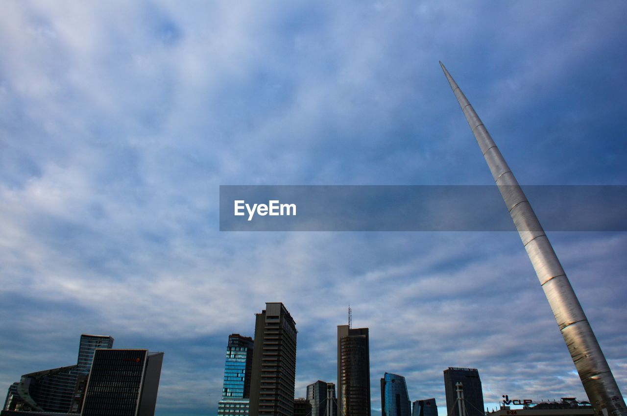 architecture, built structure, building exterior, cloud - sky, sky, city, tall - high, building, office building exterior, skyscraper, office, tower, modern, no people, nature, low angle view, landscape, urban skyline, cityscape, outdoors, financial district, spire