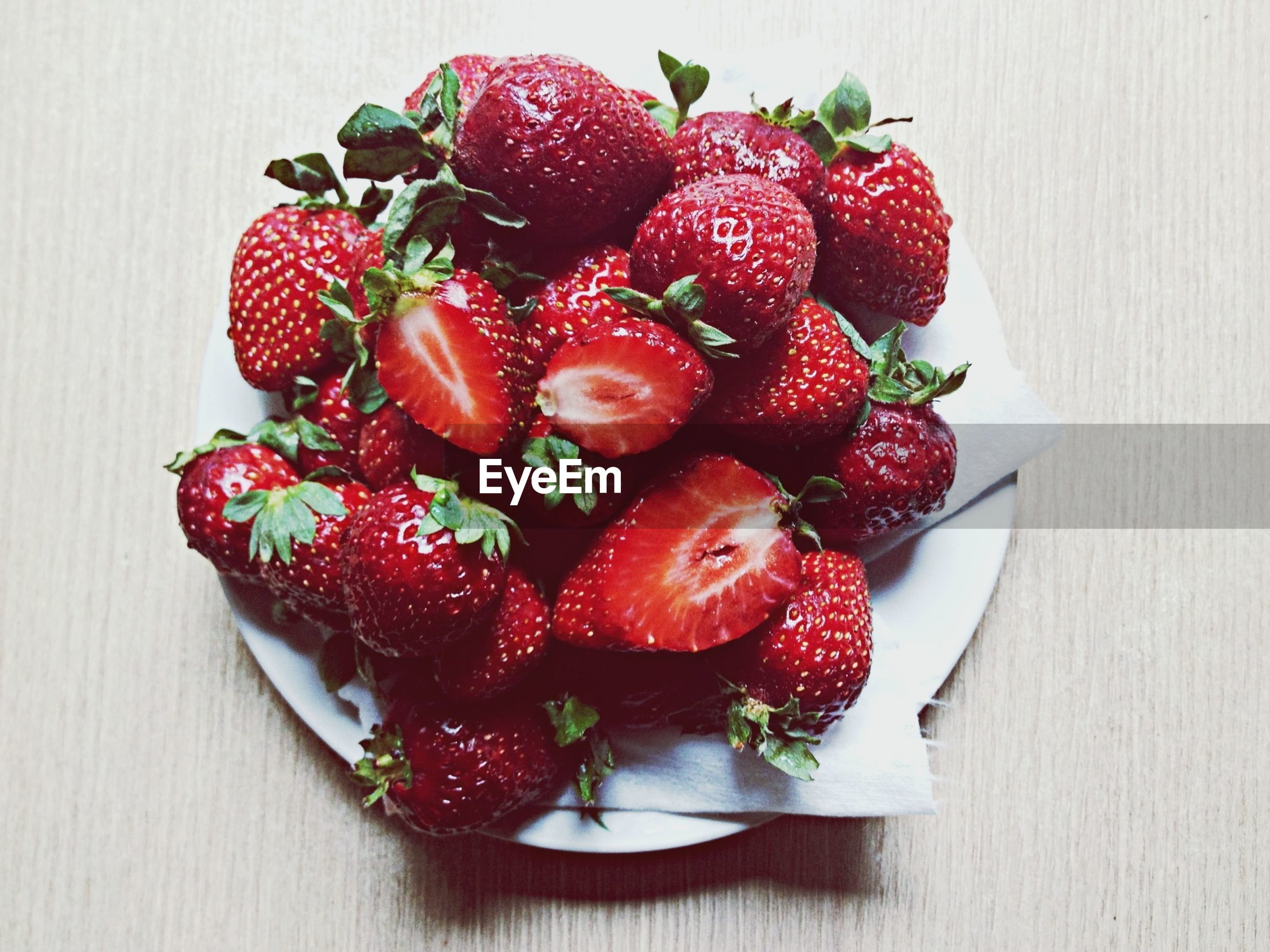 food and drink, fruit, freshness, food, red, indoors, strawberry, healthy eating, still life, berry fruit, table, raspberry, berry, high angle view, ripe, close-up, cherry, juicy, directly above, bowl