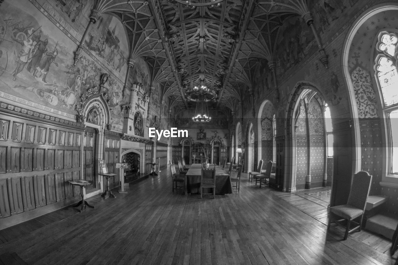 indoors, arch, architecture, window, chair, built structure, no people, day