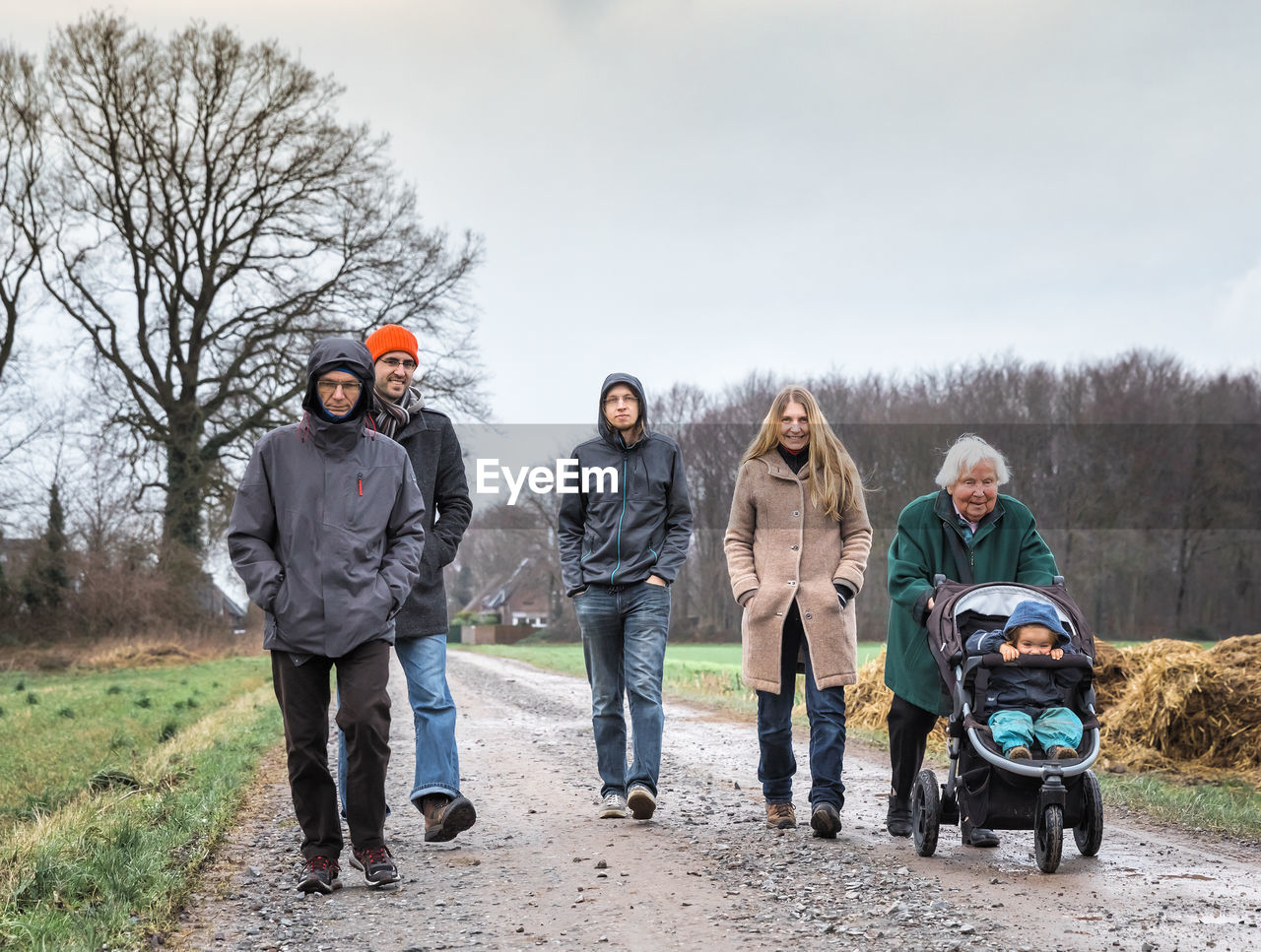 men, full length, group of people, togetherness, real people, leisure activity, sky, adult, women, males, day, winter, lifestyles, looking at camera, portrait, warm clothing, females, nature, front view, young men, mature men, mature adult, outdoors