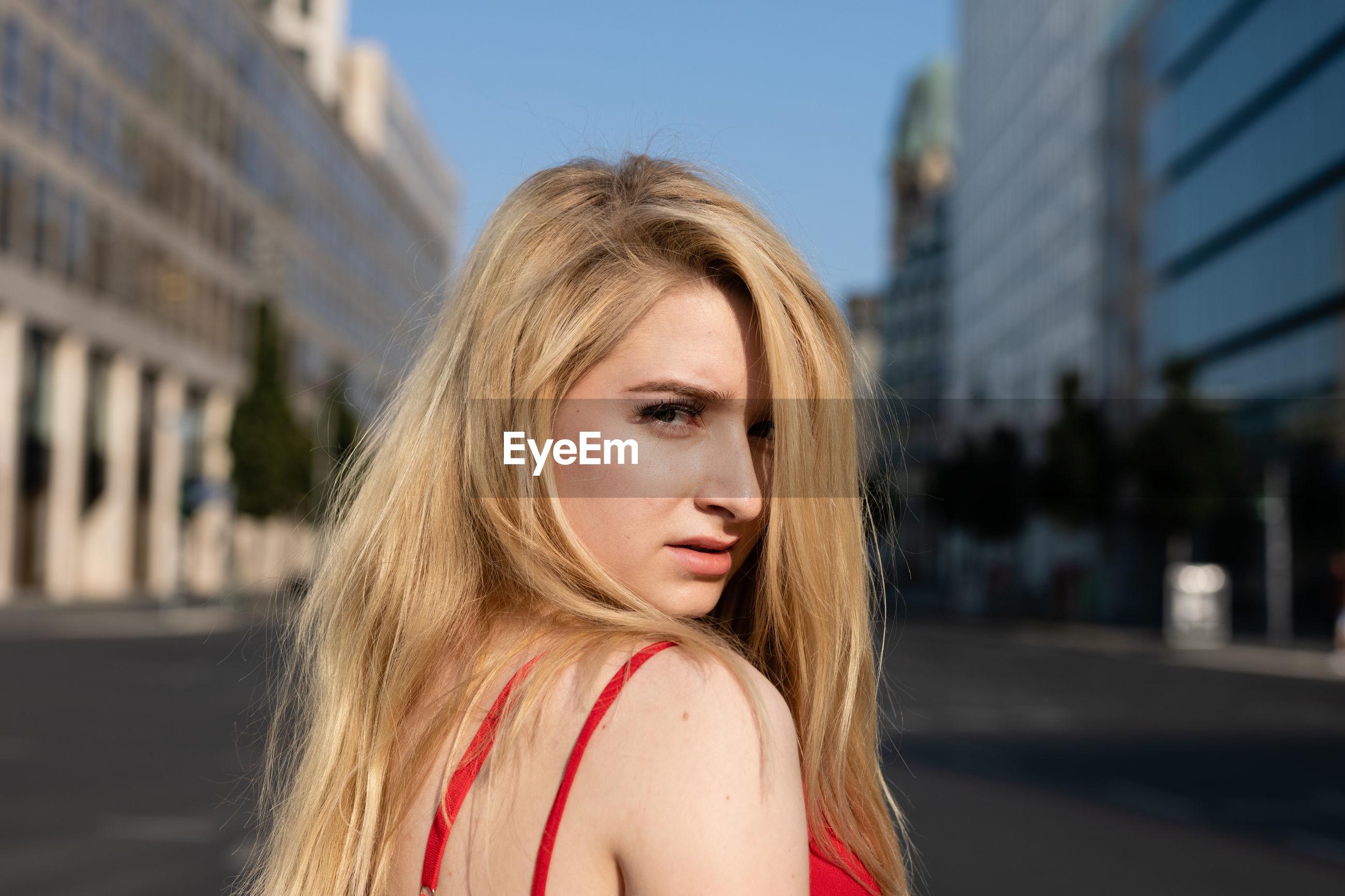 Portrait of beautiful woman on road in city