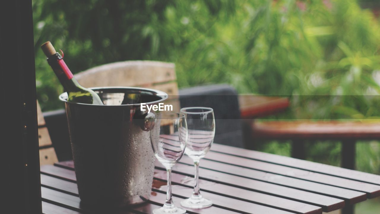 drink, food and drink, refreshment, glass, table, focus on foreground, drinking glass, day, no people, household equipment, alcohol, wine, freshness, food, close-up, still life, nature, wineglass, glass - material, transparent, outdoors