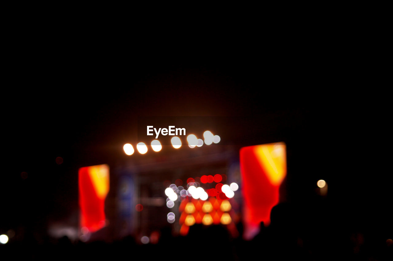 illuminated, night, copy space, outdoors, real people, crowd, close-up, people