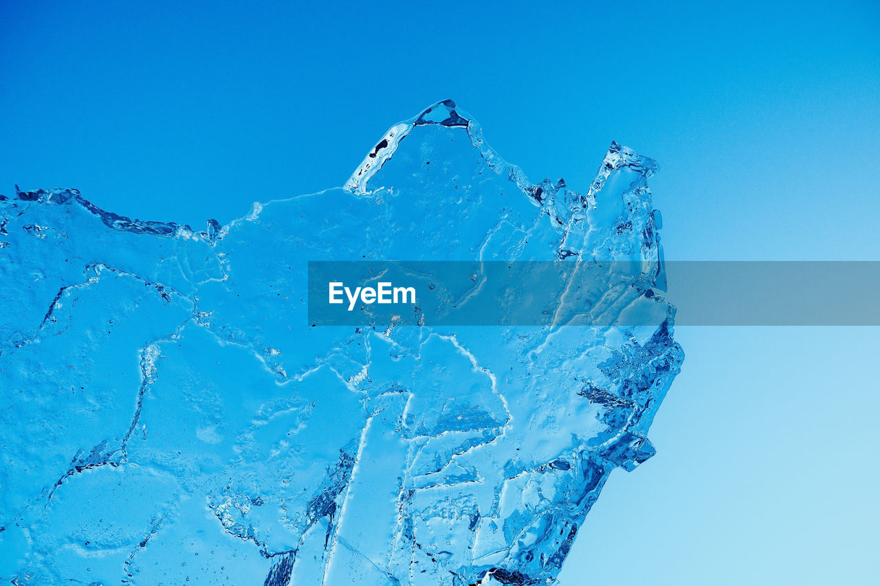 blue, sky, clear sky, cold temperature, winter, nature, no people, water, snow, day, low angle view, motion, scenics - nature, outdoors, ice, beauty in nature, frozen, splashing, blue background