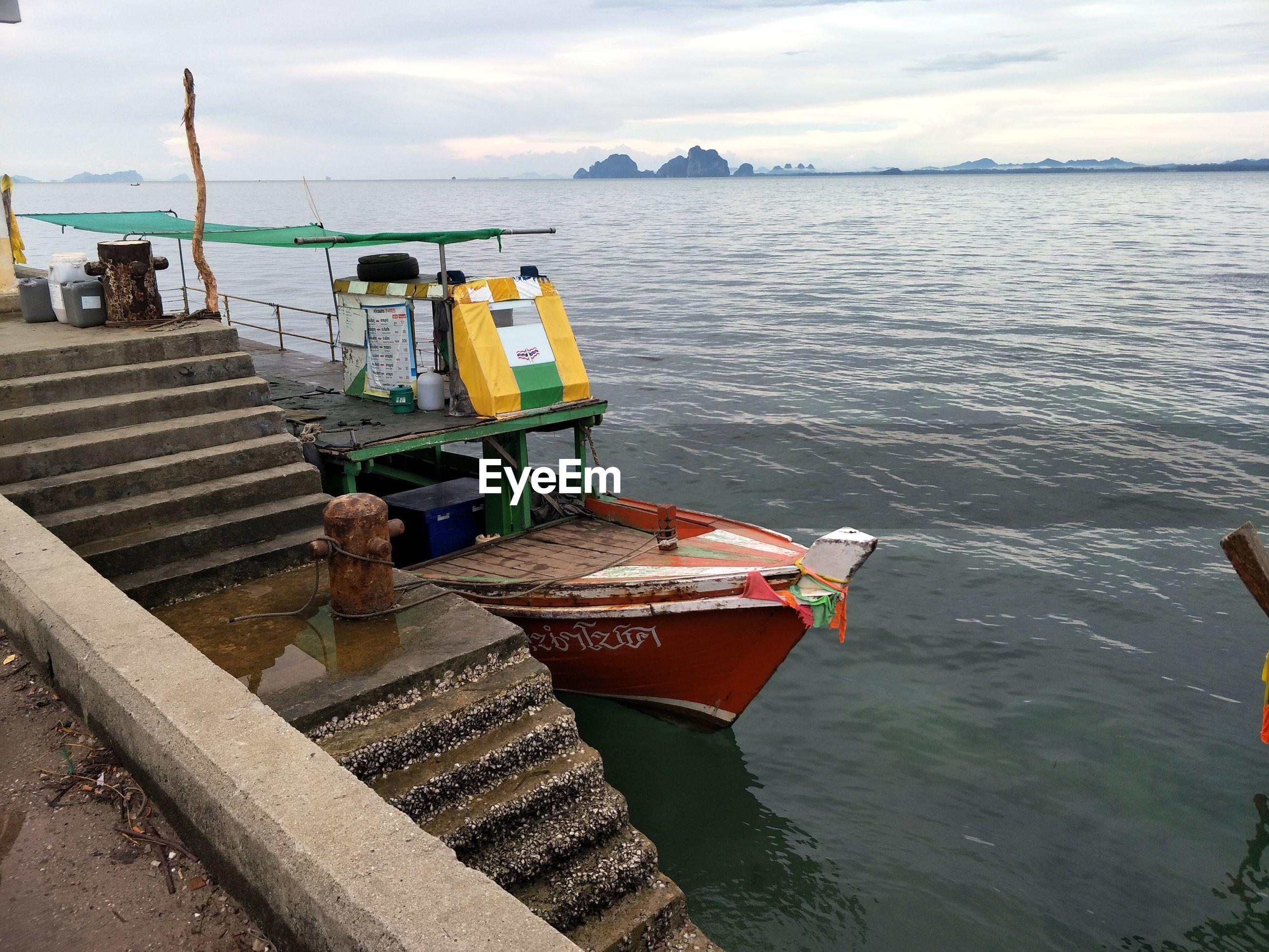 NAUTICAL VESSEL MOORED ON SEA AGAINST SKY