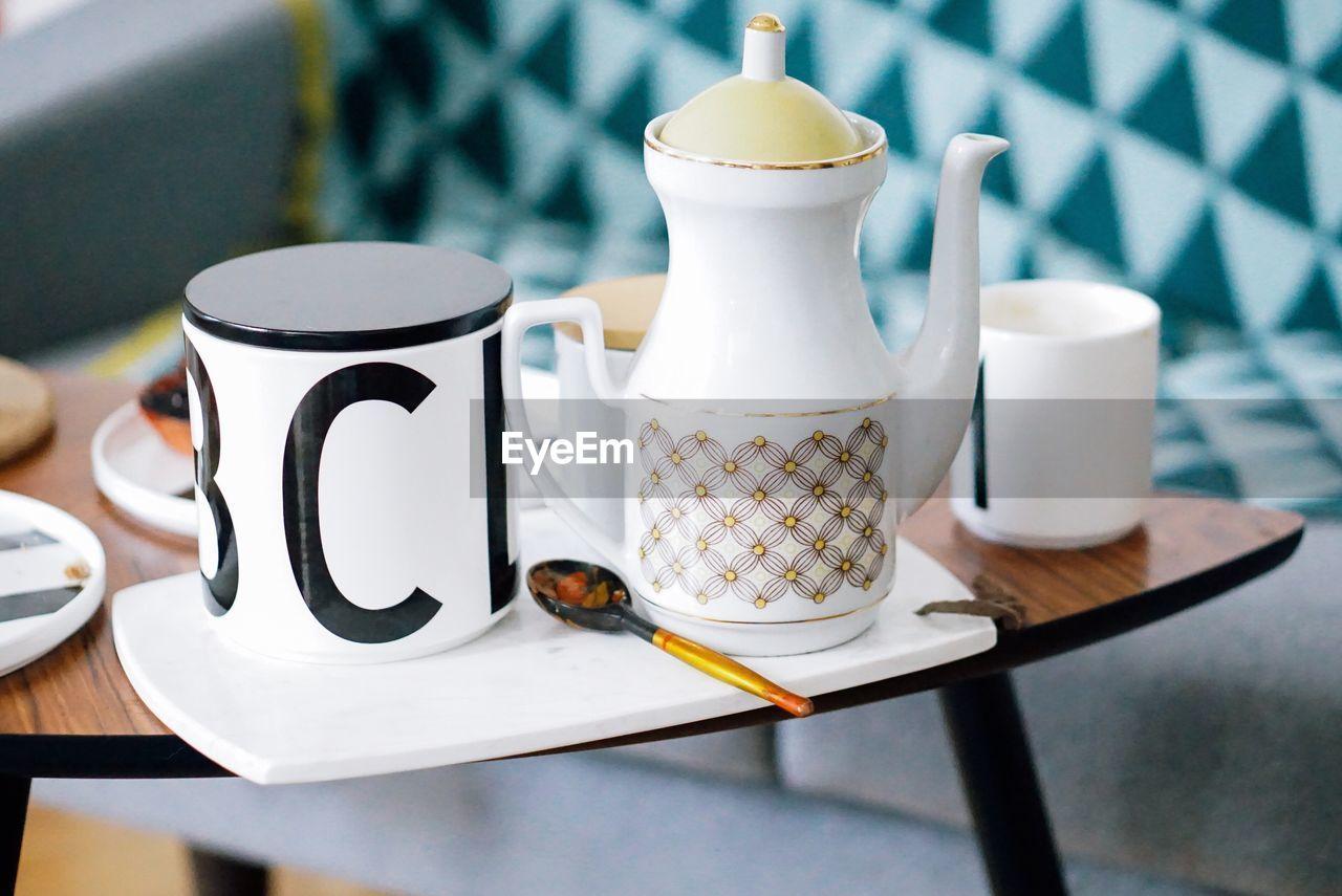 High angle view of tea set on table