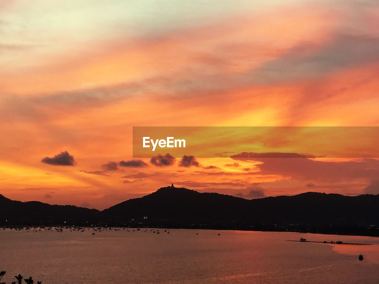 sunset, sky, beauty in nature, cloud - sky, orange color, scenics - nature, tranquil scene, tranquility, water, nature, silhouette, idyllic, mountain, no people, land, sea, non-urban scene, outdoors, dramatic sky, romantic sky