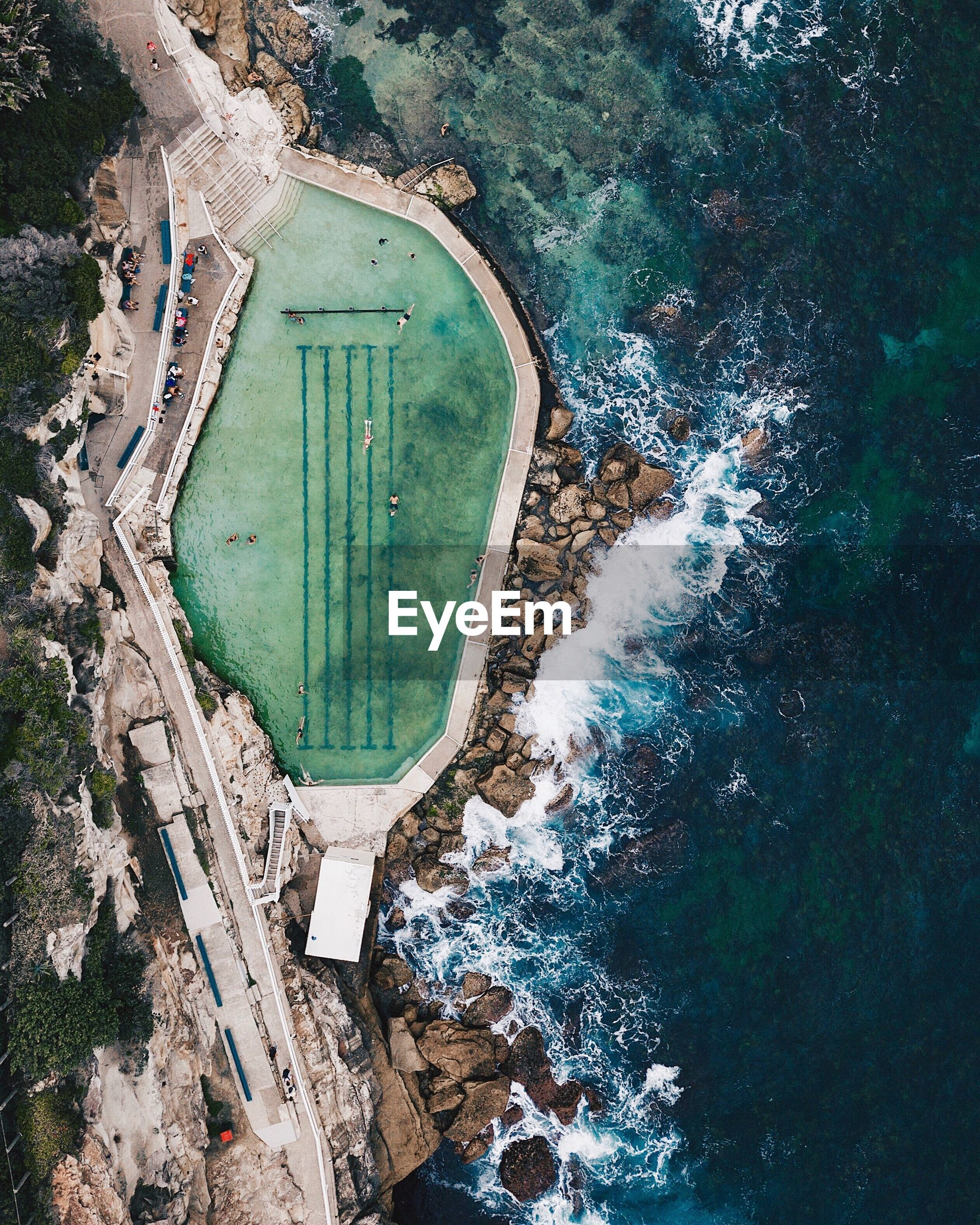 Aerial view of infinity pool by sea