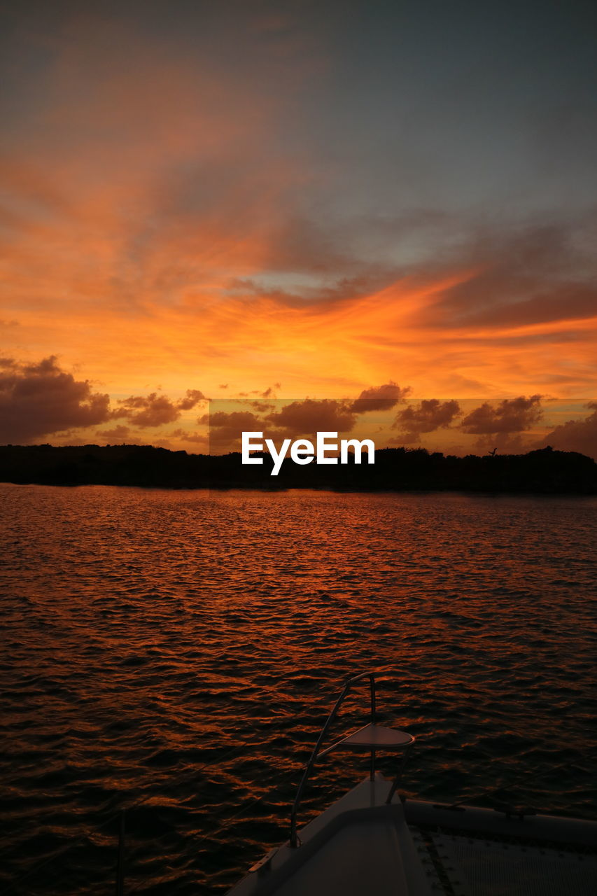 sunset, sky, cloud - sky, water, beauty in nature, scenics - nature, orange color, nautical vessel, tranquil scene, tranquility, mode of transportation, nature, no people, transportation, idyllic, sea, non-urban scene, outdoors