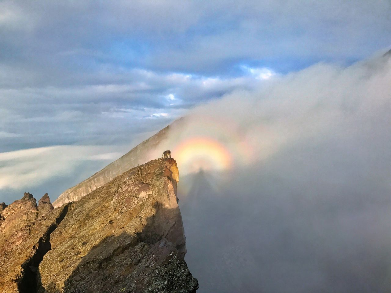 sky, nature, beauty in nature, cloud - sky, scenics, outdoors, cliff, day, adventure, mountain, landscape, no people