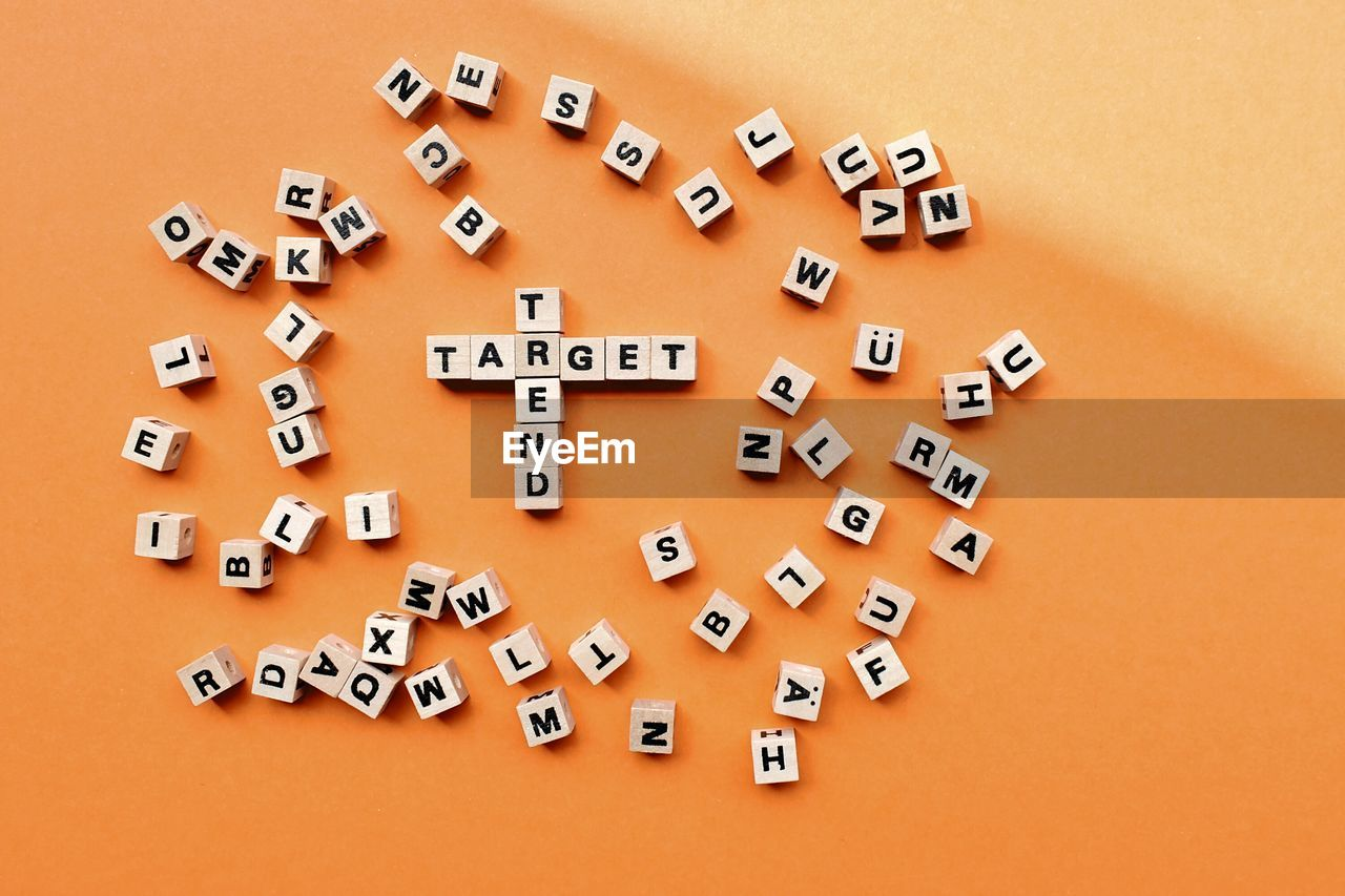 indoors, large group of objects, no people, studio shot, still life, colored background, toy, high angle view, text, letter, alphabet, communication, relaxation, shape, directly above, education, capital letter, table, close-up, toy block