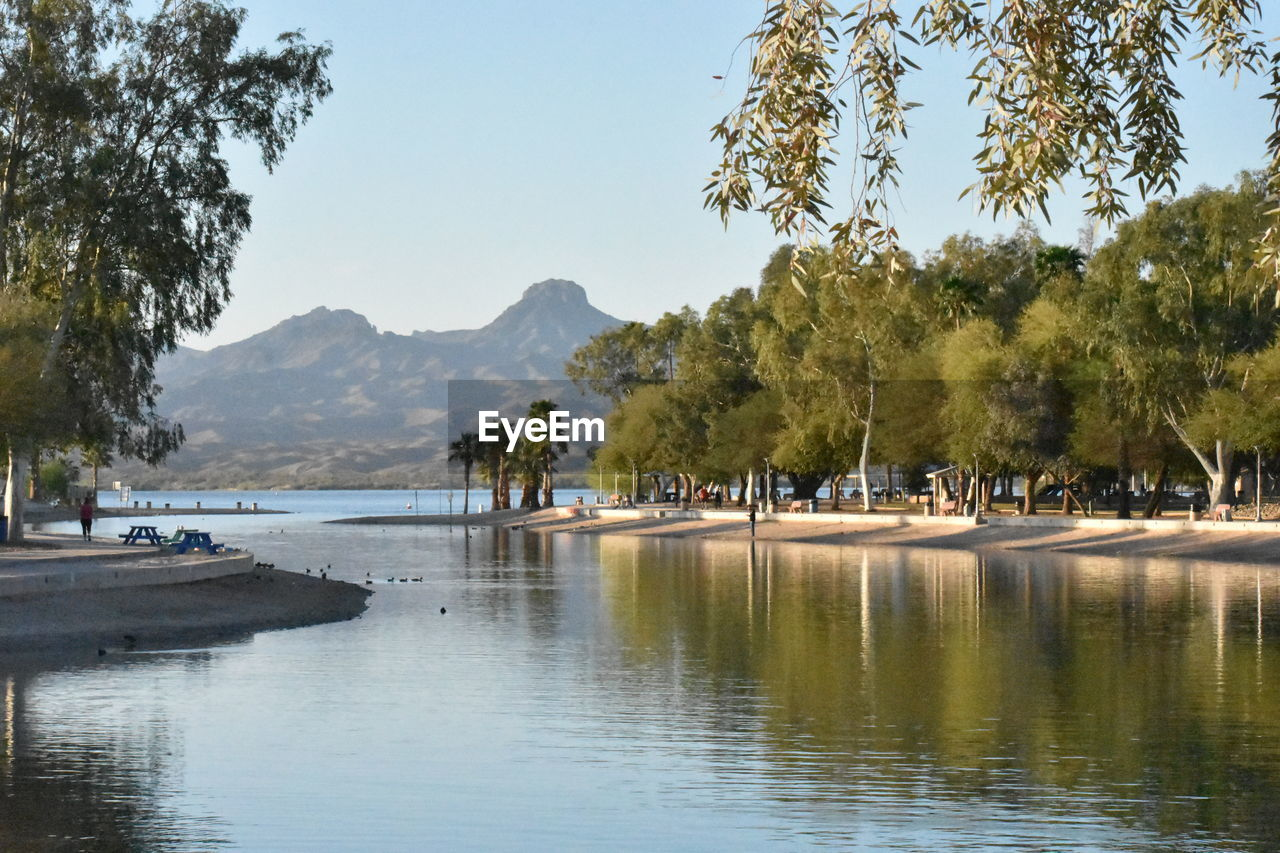 water, tree, plant, sky, mountain, waterfront, beauty in nature, reflection, nature, scenics - nature, tranquility, tranquil scene, lake, day, clear sky, no people, nautical vessel, outdoors, transportation