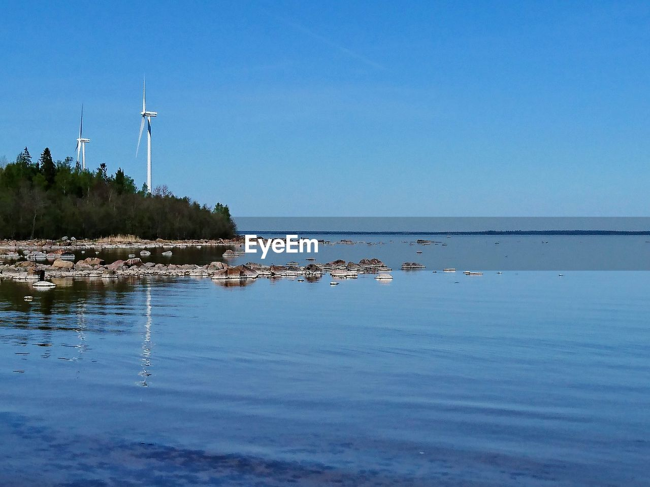 alternative energy, water, wind power, wind turbine, renewable energy, environmental conservation, nature, fuel and power generation, windmill, blue, waterfront, beauty in nature, scenics, no people, day, outdoors, sea, industrial windmill, tranquility, sky, clear sky