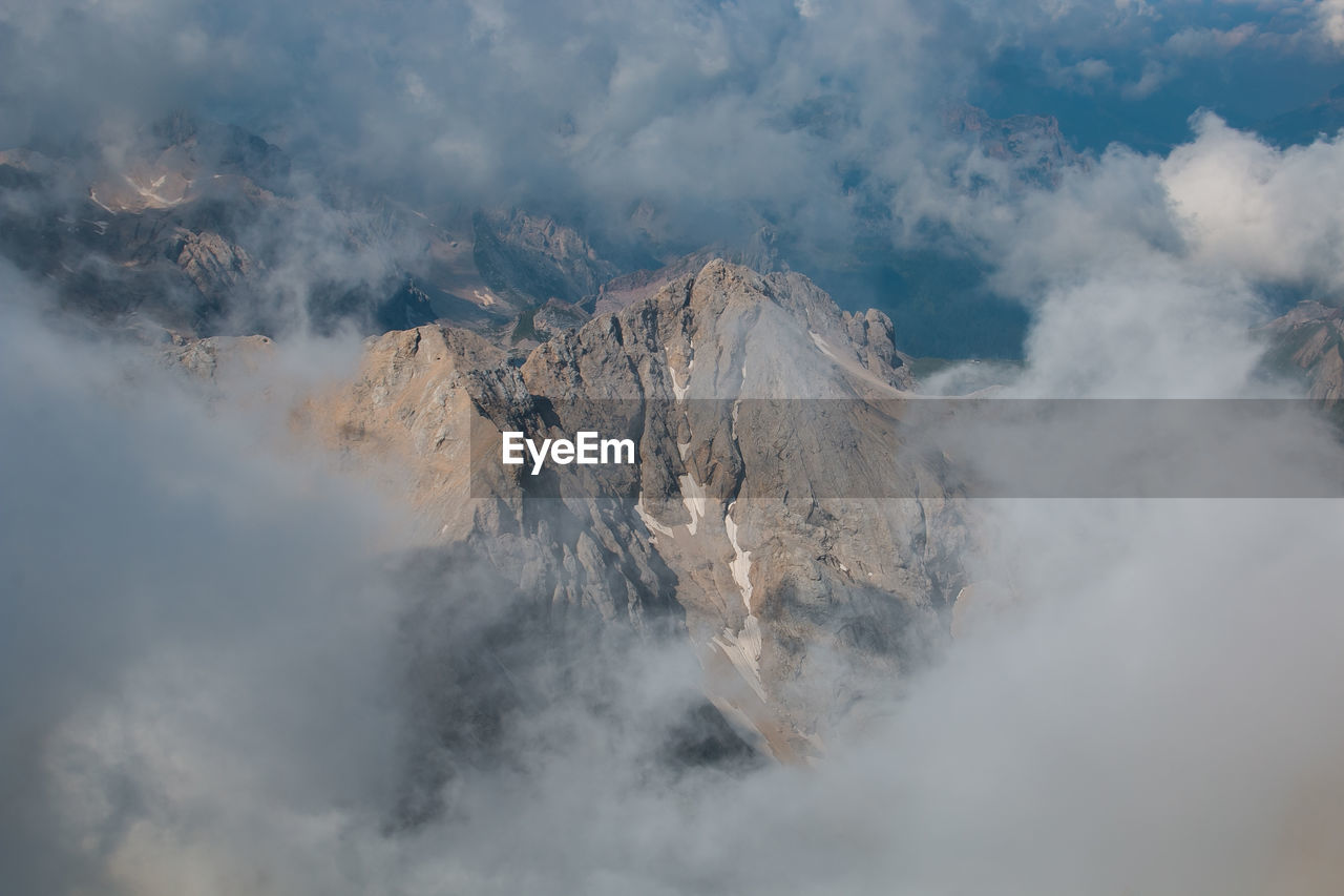 mountain, cloud - sky, scenics - nature, geology, beauty in nature, non-urban scene, smoke - physical structure, sky, nature, tranquil scene, tranquility, mountain range, physical geography, day, environment, no people, landscape, volcano, heat - temperature, formation, outdoors, pollution, mountain peak, volcanic crater