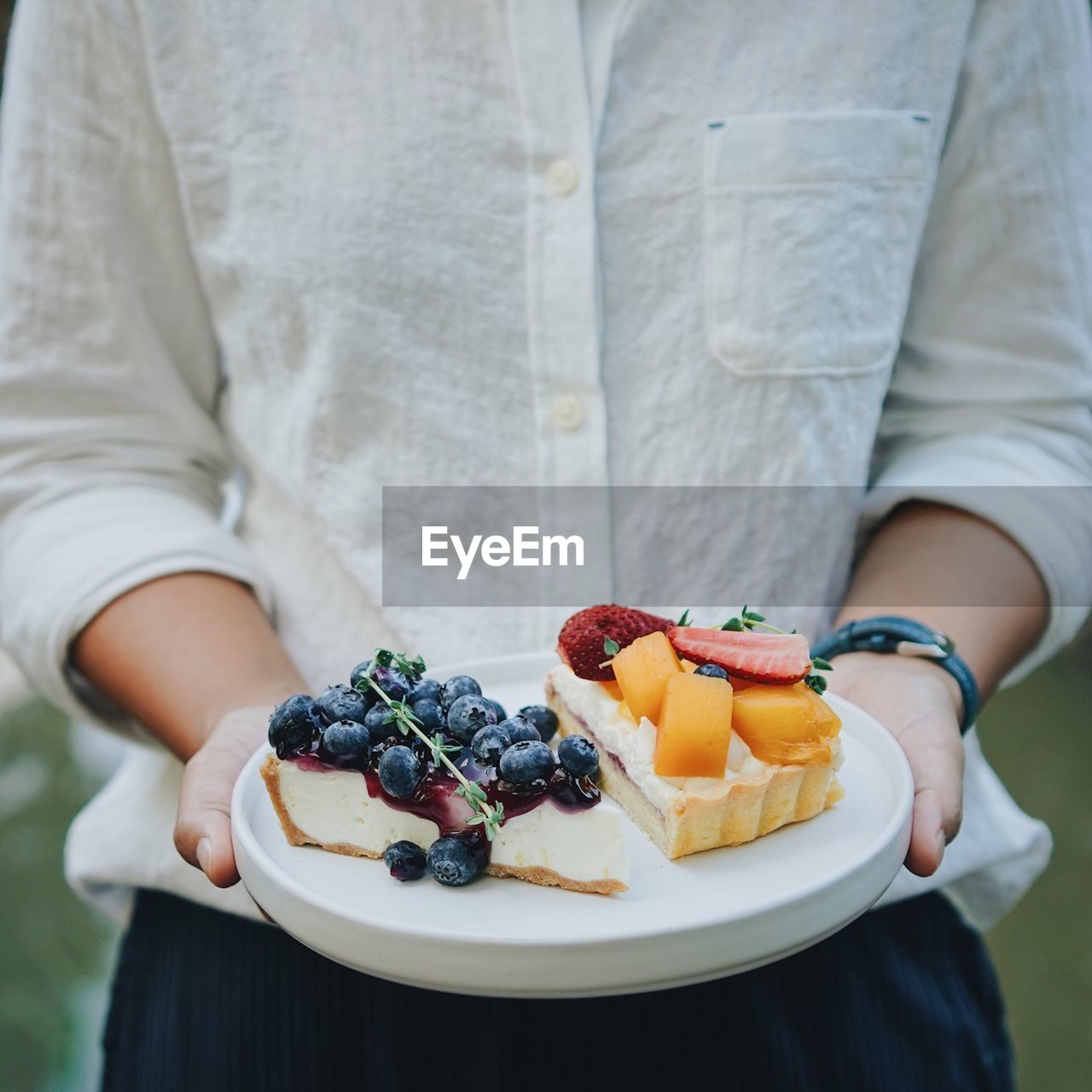 food and drink, food, healthy eating, fruit, one person, berry fruit, midsection, freshness, wellbeing, real people, blueberry, strawberry, lifestyles, front view, raspberry, holding, healthy lifestyle, hand, focus on foreground, ripe, breakfast, temptation