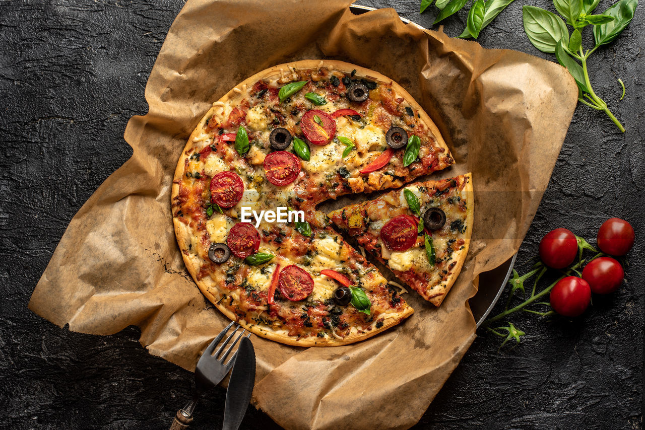 food, food and drink, pizza, vegetable, tomato, italian food, fruit, herb, directly above, wood - material, paper, basil, freshness, rustic, studio shot, high angle view, meat, cheese, healthy eating, indoors, no people, meal, take out food, dinner, savory sauce
