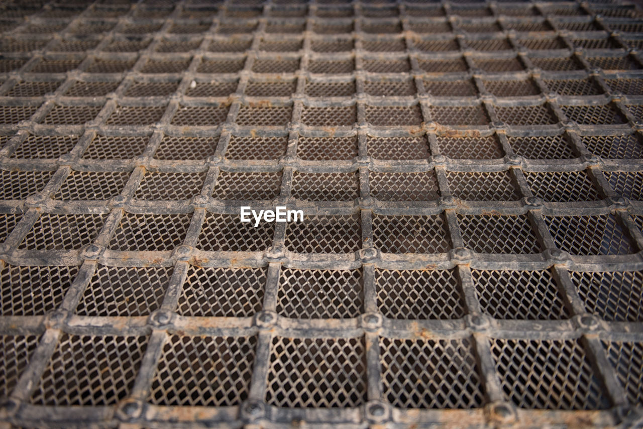 Full Frame Shot Of Rusty Metal Grate