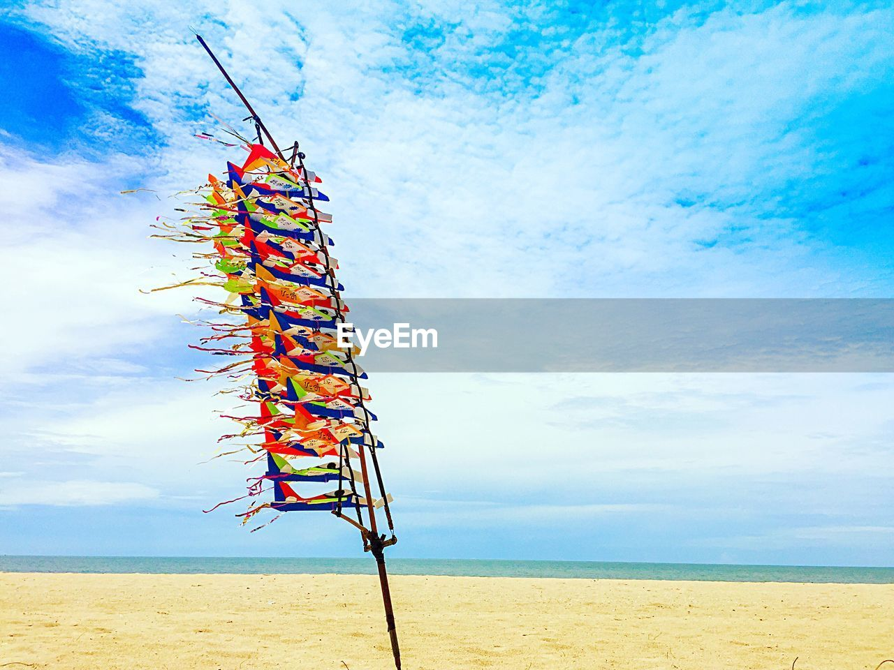 LOW ANGLE VIEW OF BEACH AGAINST BLUE SKY