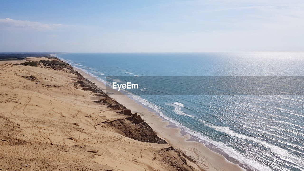 sea, horizon, water, horizon over water, beauty in nature, scenics - nature, beach, land, sky, tranquil scene, tranquility, sand, nature, idyllic, no people, non-urban scene, day, cloud - sky, outdoors