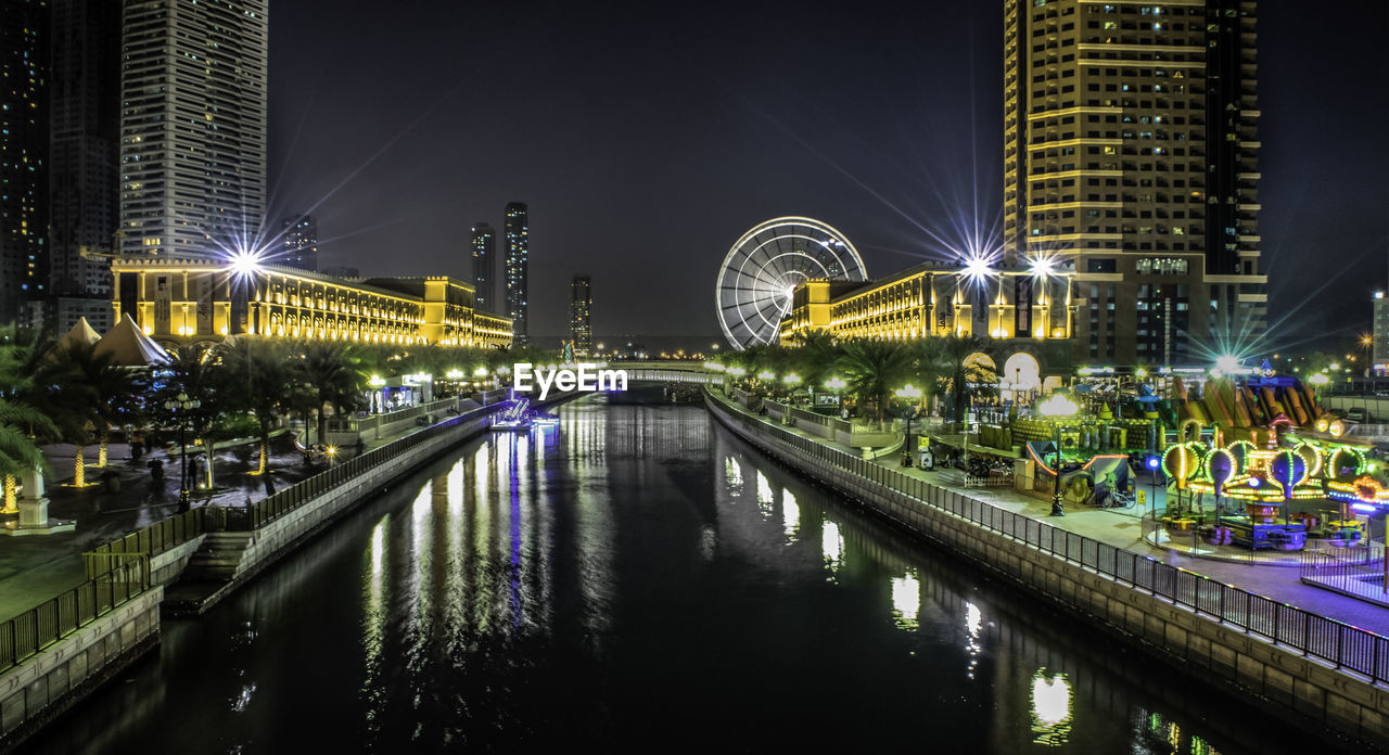 built structure, architecture, building exterior, night, illuminated, water, city, reflection, connection, river, bridge, building, bridge - man made structure, office building exterior, sky, no people, nature, transportation, waterfront, modern, skyscraper, outdoors, nightlife