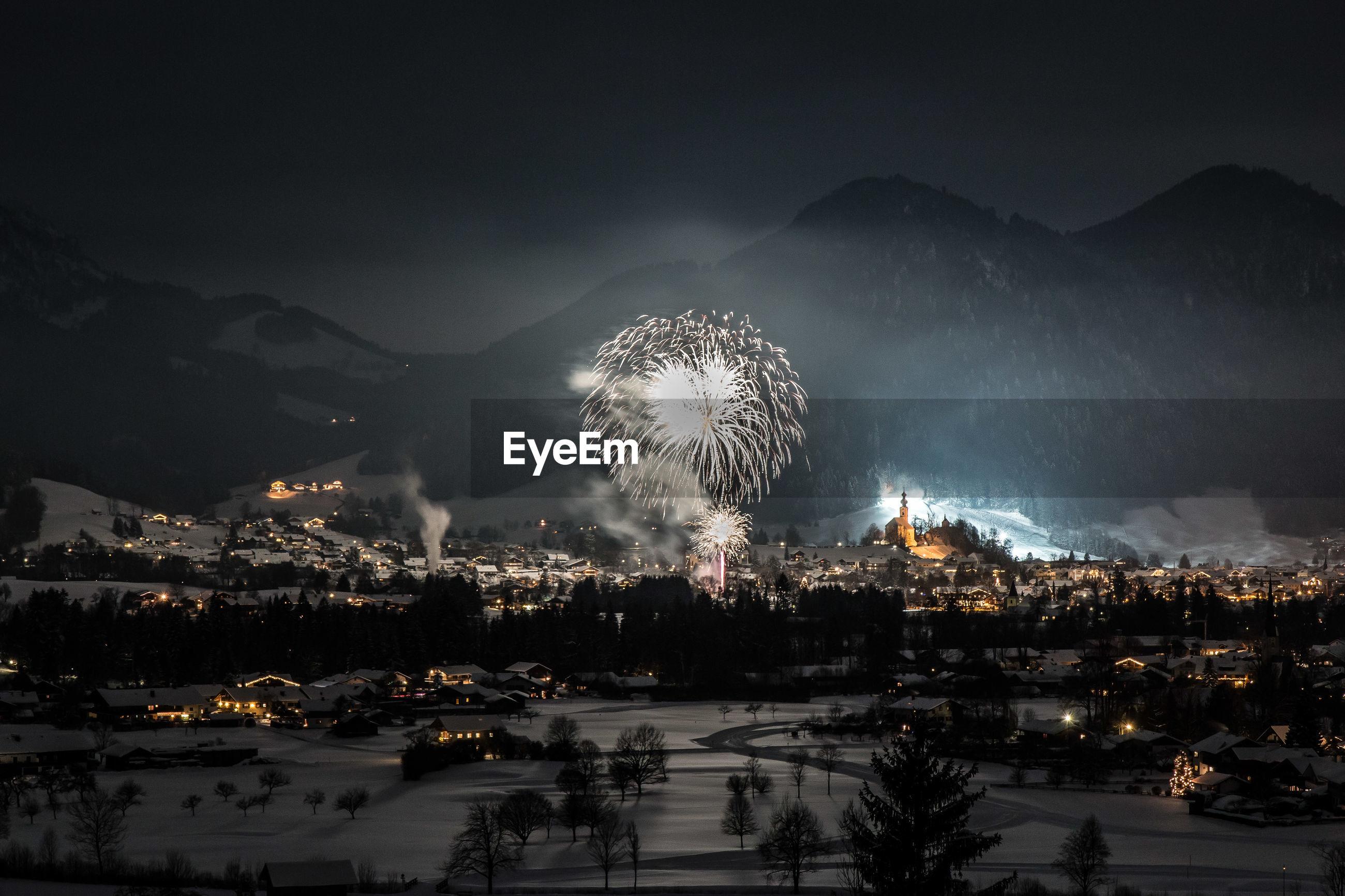 Illuminated firework at night