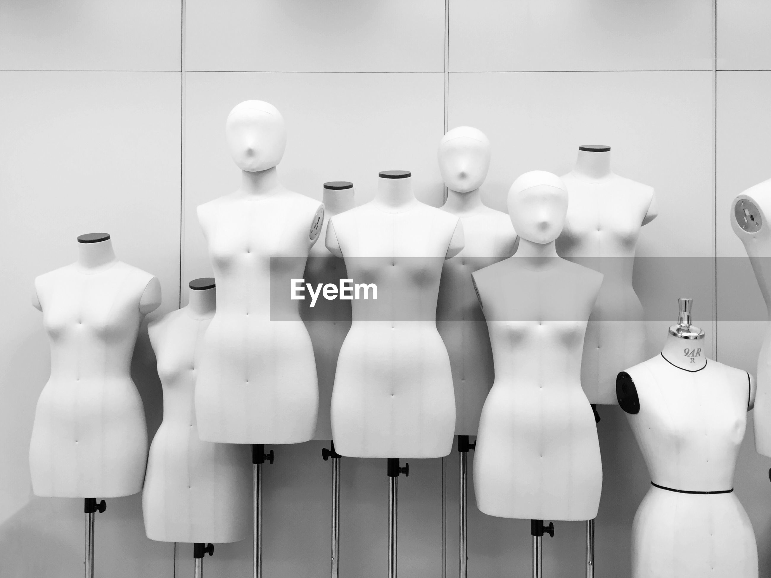 Row of mannequins on display at store