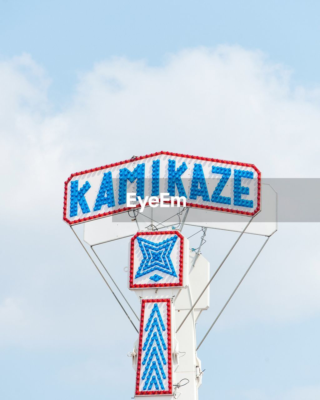 Low angle view of text on amusement park ride