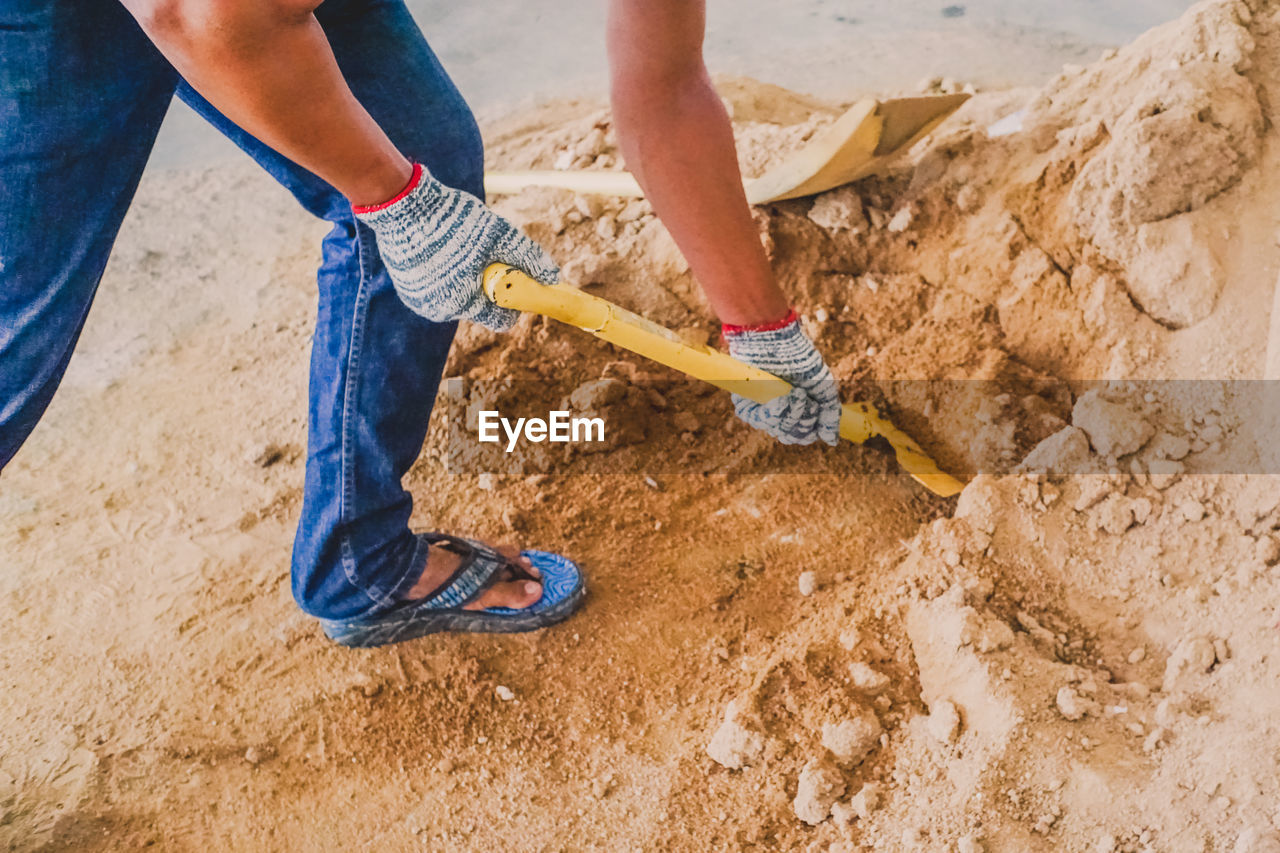 human body part, people, construction industry, low section, human hand, dirt, men, hand, land, occupation, nature, working, holding, body part, adult, industry, real people, construction site, home improvement, human limb