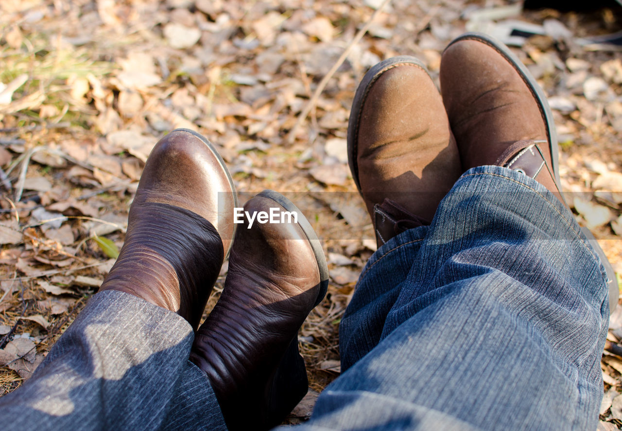 Low section of couple in shoes outdoors