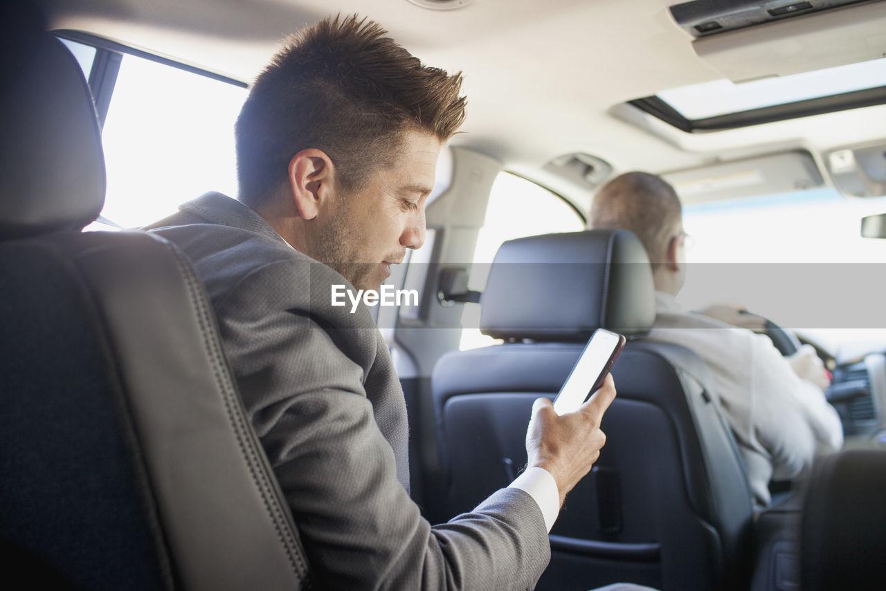 MAN SITTING IN CAR