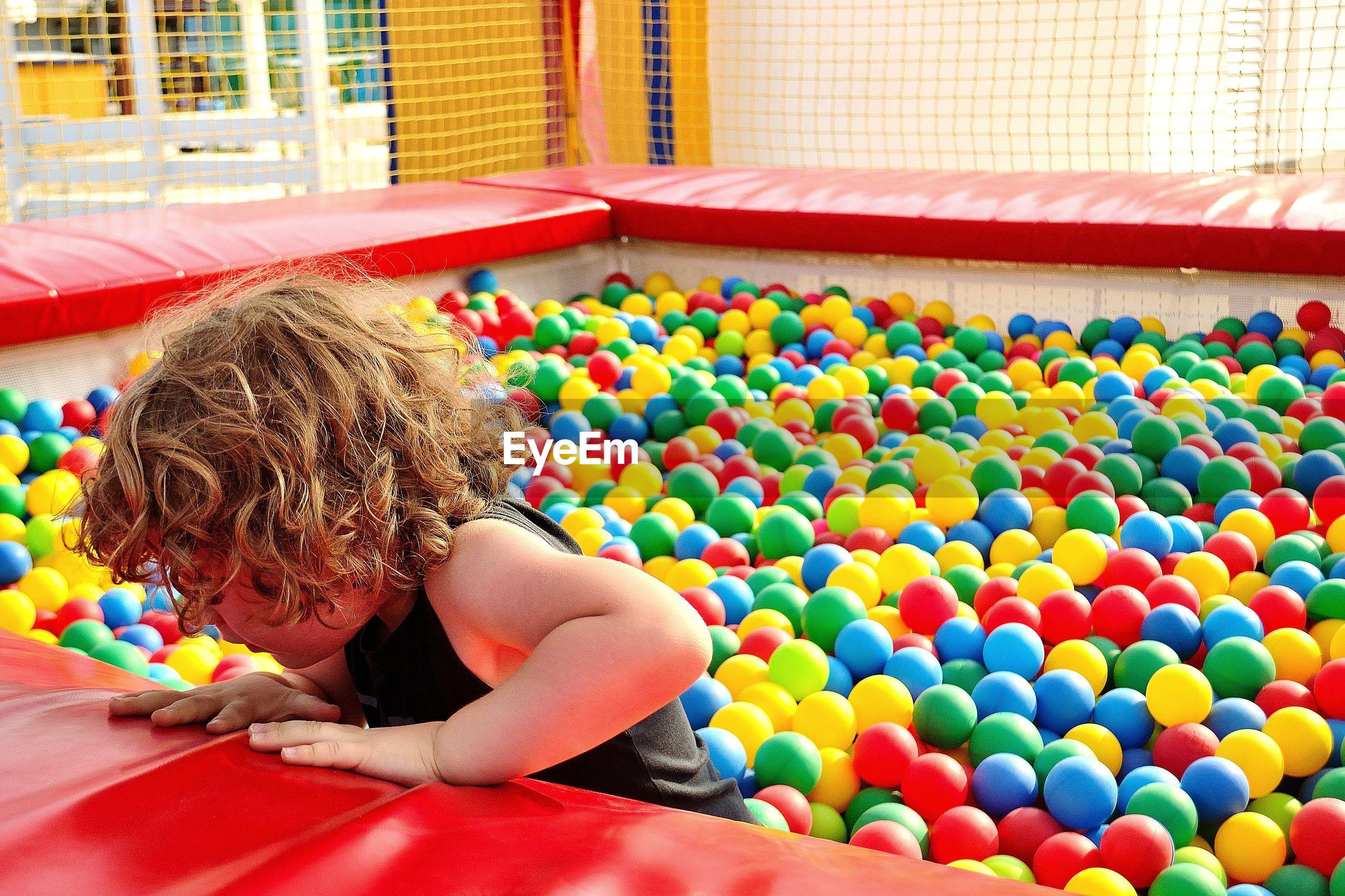 Cute boy playing in ball pool