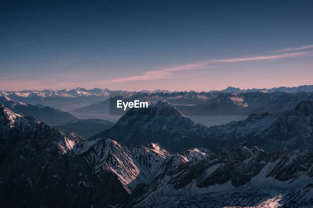 Scenic View Of Bavarian Alps Against Sky During Sunset