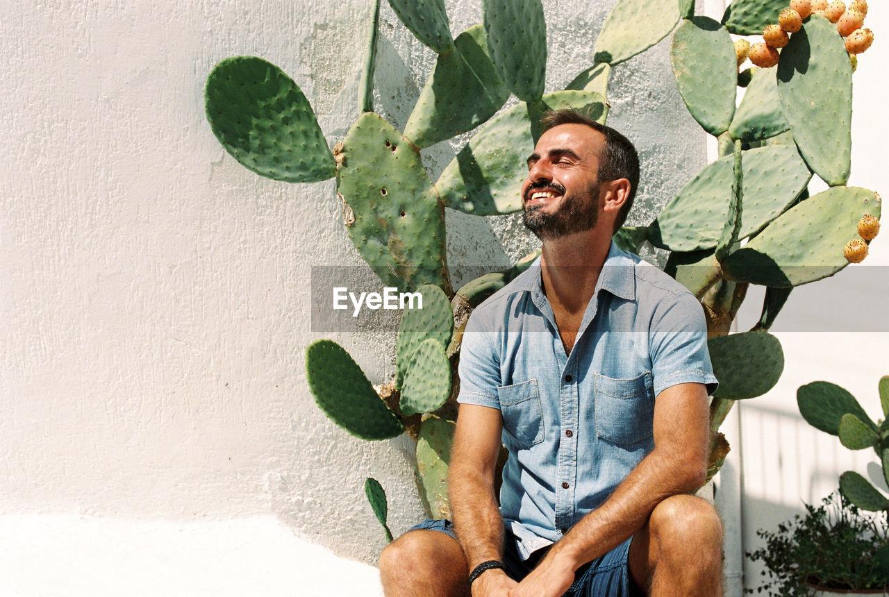 Man Sitting By Cactus