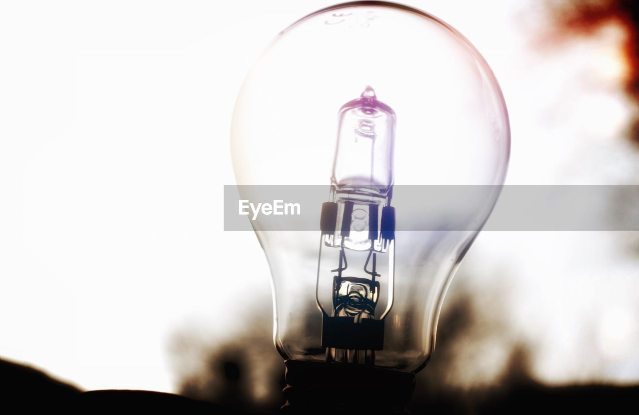 Close-Up Of Light Bulb Against Clear Sky