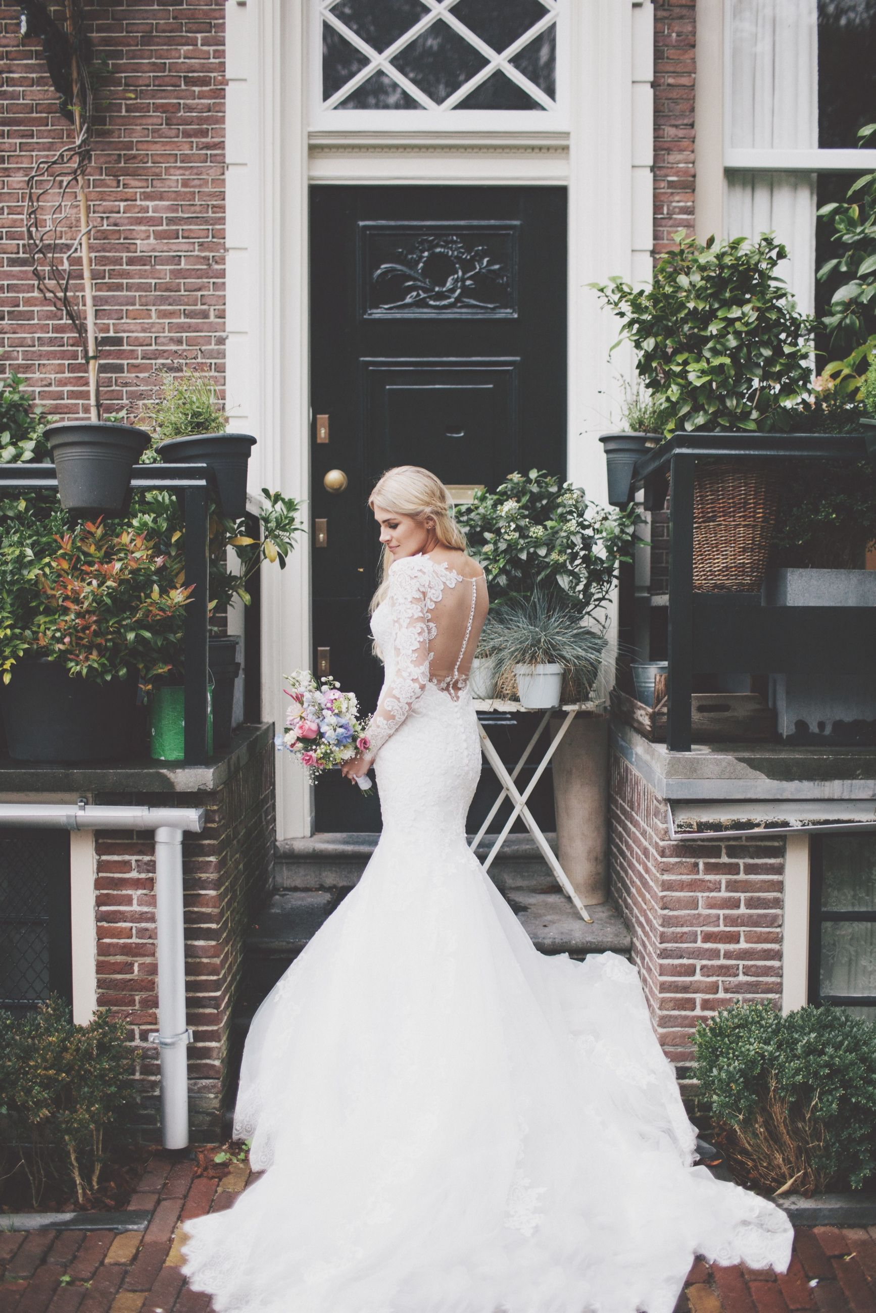 bride, wedding, wedding dress, architecture, real people, white color, built structure, beautiful woman, outdoors, building exterior, life events, celebration, young women, young adult, one person, full length, day, lifestyles, standing, women, groom, well-dressed, tiara